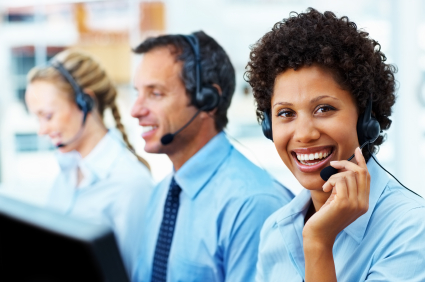 Portrait of customer service operators communicating in a call center